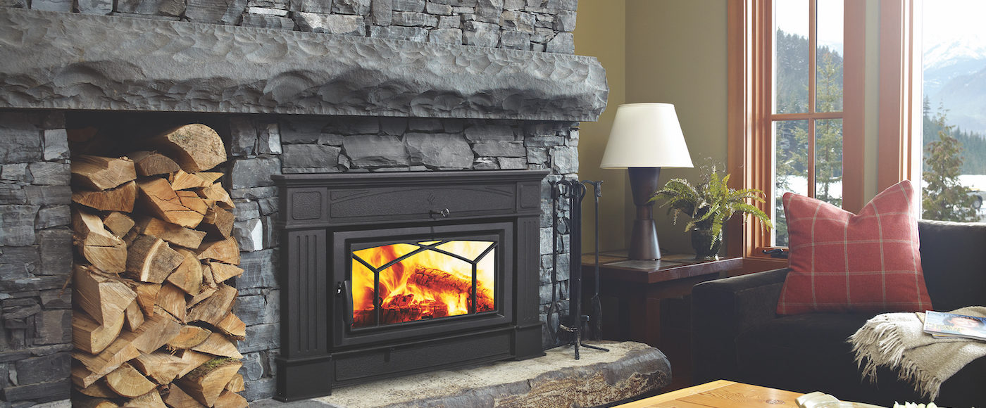 Beautiful Stone Fireplace with wood stove insert